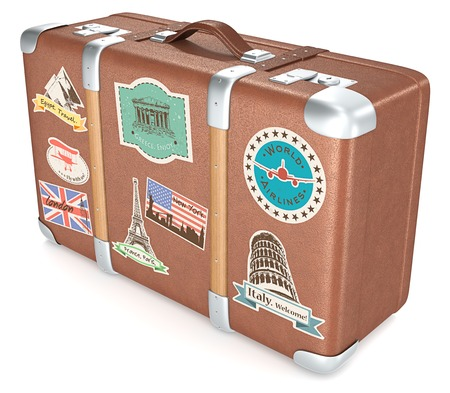 Foto de Vintage Suitcase. Leather suitcase with retro travel stickers. - Imagen libre de derechos