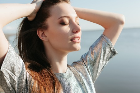 Photo for Beautiful girl enjoying the sun and the warmth - Royalty Free Image