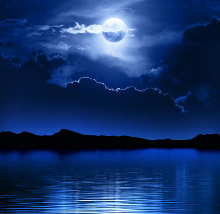 Foto de Fantasy Moon and Clouds over water  Elements of this image furnished by NASA-   http   visibleearth nasa gov  - Imagen libre de derechos