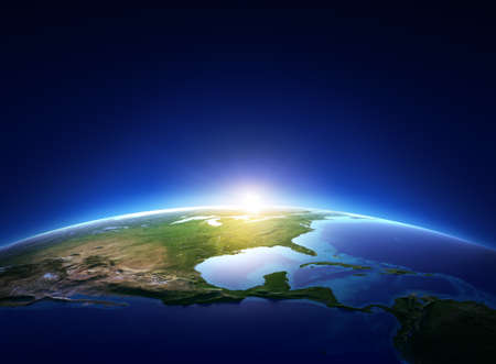 Earth sunrise over cloudless North America  Elements of this image furnished by NASA