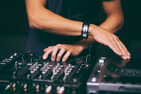 Photo for DJ controls a remote at a club party - Royalty Free Image