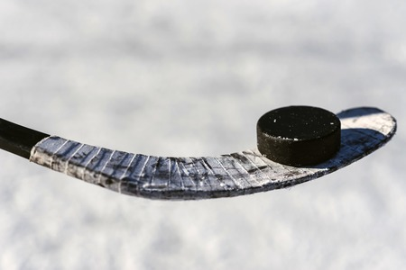 Photo for close-up stick and puck on the ice background - Royalty Free Image