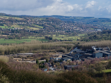 Foto de Darley Dale, Derbyshire, UK: February 11, 2018: Looking across Darley Dale with the H J Enthoven Ltd battery recycling plant in  view. A subsiduary of Ecobat Technologies, the site is the largest lead recycling plant in Europe. - Imagen libre de derechos