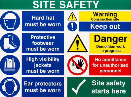 Photo pour Brightly colored building site safety warning signs - image libre de droit
