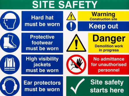 Foto de Brightly colored building site safety warning signs - Imagen libre de derechos