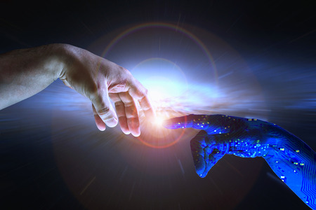 Foto de AI hand reaches towards a human hand as a spark of understanding technology reaches across to humanity. Artificial Intelligence concept with copy space area. Blue flesh image. - Imagen libre de derechos
