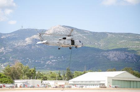 Foto de Special forces training rappel from helicopter black hawk - Imagen libre de derechos