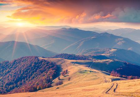 Photo pour Colorful autumn sunrise in the Carpathian mountains. Krasna ridge, Ukraine, Europe. - image libre de droit