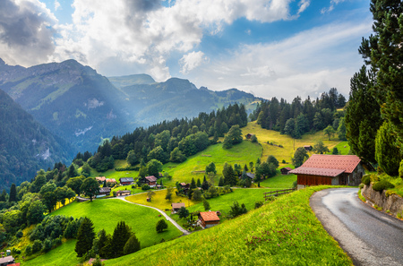 Foto de Colorful summer view of Wengen village. Beautiful outdoor scene in Swiss Alps, Bernese Oberland in the canton of Bern, Switzerland, Europe. Artistic style post processed photo. - Imagen libre de derechos