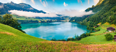 Photo pour Foggy summer panorama of Lungerersee lake. Colorful morning view of Swiss Alps, Lungern village location, Switzerland, Europe. Artistic style post processed photo. - image libre de droit