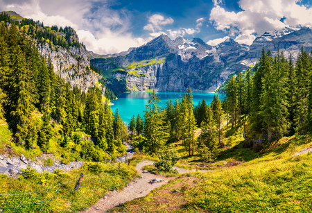 Photo for Picturesque summer view of unique Oeschinensee Lake. Sunny morning scene in the Swiss Alps with Bluemlisalp mountain, Kandersteg village location, Switzerland, Europe. - Royalty Free Image