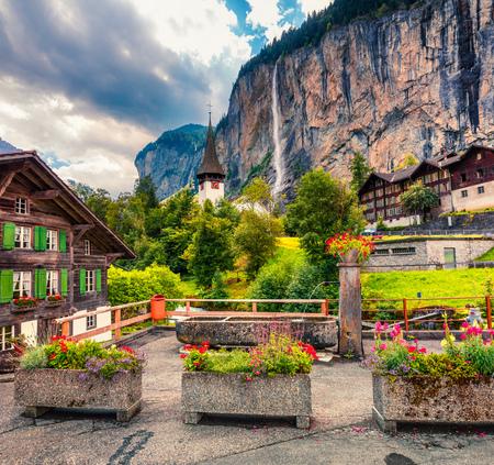 Foto de Picturesque summer view of waterfall in Lauterbrunnen village. Splendid outdoor scene in Swiss Alps, Bernese Oberland in the canton of Bern, Switzerland, Europe. Artistic style post processed photo. - Imagen libre de derechos