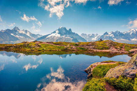 Foto de Amazing summer view of the Lac Blanc lake with Mont Blanc (Monte Bianco) on background, Chamonix location. Beautiful outdoor scene in Vallon de Berard Nature Preserve, Graian Alps, France, Europe.  - Imagen libre de derechos