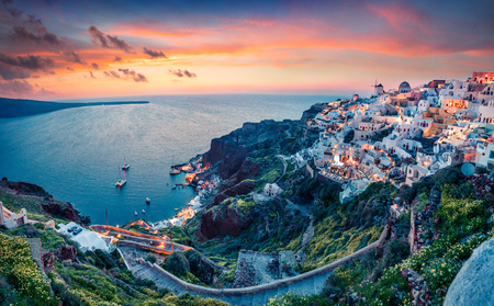 Photo for Impressive evening view of Santorini island. Picturesque spring sunset on the famous Greek resort Oia, Greece, Europe. - Royalty Free Image
