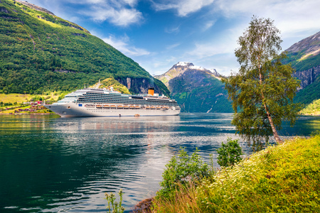 Photo pour Big cruise ship in Sunnylvsfjorden fjord. Colorful summer morning in Norway, Europe. Traveling concept background. Artistic style post processed photo. - image libre de droit