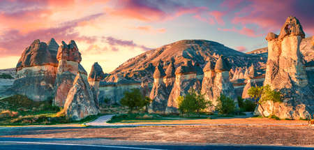 Photo pour Impressive fungous forms of sandstone in the canyon near Cavusin village, Cappadocia, Nevsehir Province in the Central Anatolia Region of Turkey, Asia. Beauty of nature concept background. - image libre de droit
