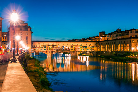 Photo for Fantastic evening cityscape of Florence with Old Palace (Palazzo Vecchio or Palazzo della Signoria) on background and Ponte Vecchio bridge over Arno river. Colorful night scene of Italy, Europe. - Royalty Free Image