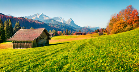 Photo pour Splendid morning scene of Garmisch-Partenkirchen village with Zugspitze mountain range on background. Beautifel autumn view of Bavarian Alps, Germany, Europe. Beauty of countryside concept background. - image libre de droit