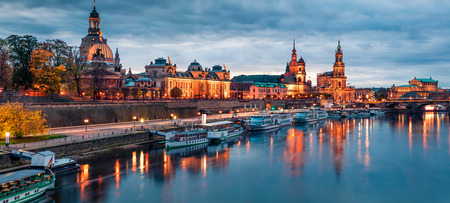 Photo for Incredible evennig panorama of Cathedral of the Holy Trinity or Hofkirche, Bruehl's Terrace or The Balcony of Europe. Dramatic autumn sunset on Elbe river in Dresden, Saxony, Germany, Europe. - Royalty Free Image