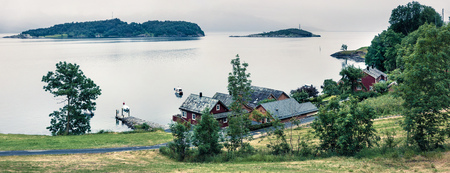 Foto per Typical countryside Norwegian landscape. Misty summer panorama of Norway, Europe. Beauty of countryside concept background. - Immagine Royalty Free