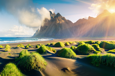 Photo pour Impressive summer view of green dunes on the Stokksnes headland with Vestrahorn (Batman) mountain on background, southeastern Iceland, Europe. Beauty of nature concept background. - image libre de droit