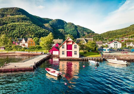 Foto per Attractive summer view of typical Norwegian village Jondal, on the shore of fjord. Sunny morning panorama of countryside, Norway, Europe. Traveling concept background. - Immagine Royalty Free
