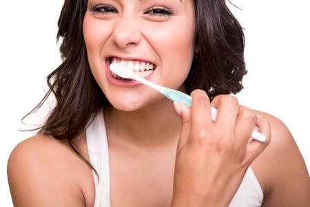 Foto de Smiling young woman with healthy teeth holding a tooth brush - Imagen libre de derechos