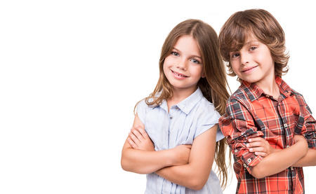 Photo pour Cool little kids posing over white background - image libre de droit