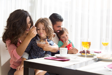 Photo for Young latin family having breakfast with kids - Royalty Free Image