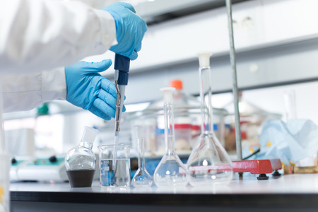 Foto de Chemical scientist working in modern biological laboratory - Imagen libre de derechos
