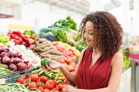Photo for Afro woman shopping organic veggies and fruits - Royalty Free Image