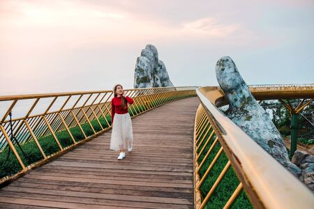 Photo for Travel woman at Golden Bridge in Ba Na Hills ,Danang Vietnam - Royalty Free Image