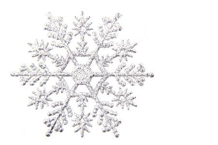 Foto de nice snowflake isolated on the white background - Imagen libre de derechos