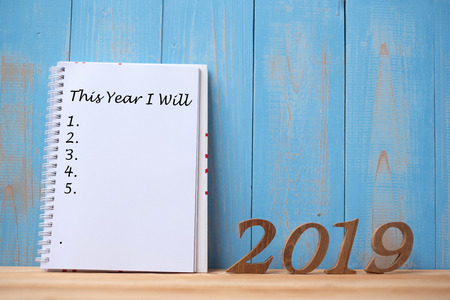 """Photo pour 2019 Happy New years with notebook """" This Year I Will """" text and wooden number on table and copy space. New Start, Resolution, Goals and Mission Concept - image libre de droit"""