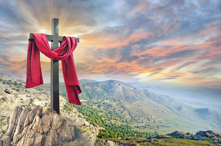 Foto per cross with red cloth against the dramatic sky - Immagine Royalty Free