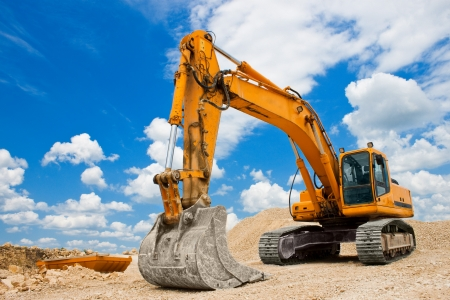 Photo for Yellow Excavator at Construction Site - Royalty Free Image