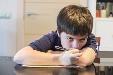 Photo for Child doing school homework at home - Royalty Free Image