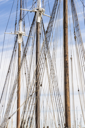 masts and furled sails of an old sailing ship in the port of Barcelona