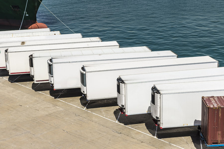Foto de Reefer containers waiting to board at the port of Barcelona, Catalonia, Spain - Imagen libre de derechos