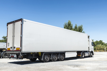 Photo pour White truck equipped with refrigeration goods parked at a gas station in Spain - image libre de droit