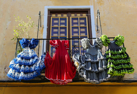 Photo for Traditional flamenco dresses at a house in Malaga, Andalusia, Spain. - Royalty Free Image
