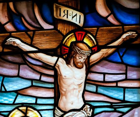 Foto de Stained glass window depicting the Crucifixion in the church of San Andres de Texeido, a famous Galician pilgrimage place in the Rias Altas region. - Imagen libre de derechos