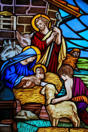 Photo pour OSTUNI, ITALY - MARCH 14, 2015: Stained glass window depicting a Nativity Scene and the Adoration of the Shepherds in the Church of Ostuni, Apulia, Italy. - image libre de droit