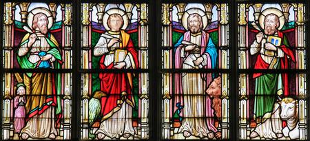 Photo pour STABROEK, BELGIUM - JUNE 27, 2015: Stained glass window depicting the Four Evangelists, Saint Matthew, Saint John, Saint Mark and Saint Luke, in the Church of Stabroek, Belgium. - image libre de droit