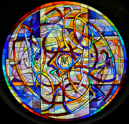 Photo for Iridescence, Stained Glass Rose Window in the Collegiata or Collegiate Church of San Gimignano, Italy. - Royalty Free Image