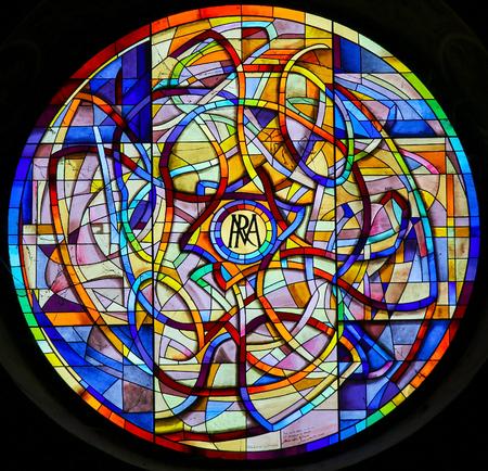 Foto de Iridescence, Stained Glass Rose Window in the Collegiata or Collegiate Church of San Gimignano, Italy. - Imagen libre de derechos