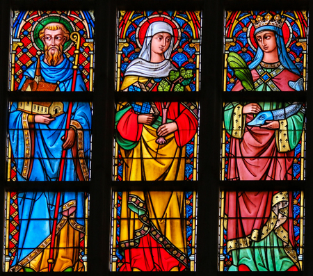 Photo for Stained Glass window in the Cathedral of Saint Bavo in Ghent, Flanders, Belgium, depicting Catholic Saints - Royalty Free Image