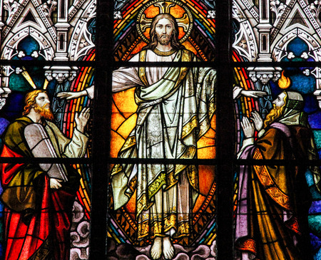 Photo for Stained glass window depicting Jesus Christ, Moses with the Ten Commandments and the Prophet Iesaiah, in the cathedral of Schwerin, Germany - Royalty Free Image