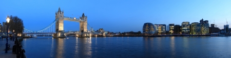 Photo pour Tower Bridge and the Thames panoramic view about London at night - image libre de droit
