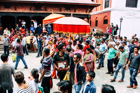 Photo for Kathmandu Nepal August 27, 2018 View of unknowns Hindu people attending a religious ceremony at the Pashupatinath temple in the morning - Royalty Free Image